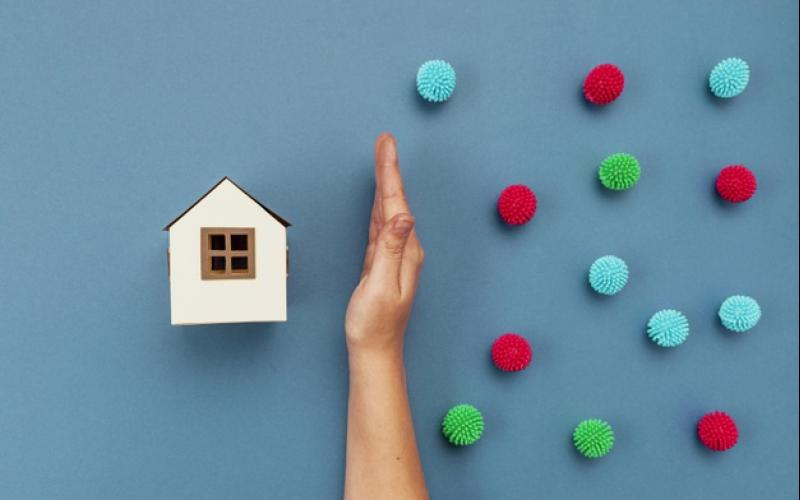 top_view_hand_separating_decorative_balls_paper_house_23_2148779170.jpg